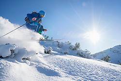 Skier jumping on snow
