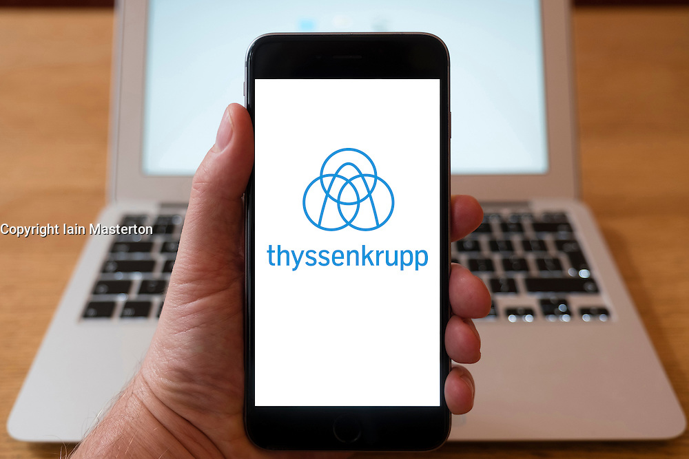 Using iPhone smartphone to display logo of Thyssenkrupp industrial multinational conglomerate