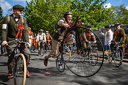 © Licensed to London News Pictures. 04/05/2019. London, UK. A man climbs onto his Penny Farthing bicycle as the annual Tweed Run bike ride sets off in Central London. Participants cycle around the capital past various landmarks wearing vintage tweed outfits. Photo credit: Rob Pinney/LNP
