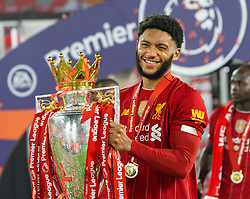 LIVERPOOL, ENGLAND - Wednesday, July 22, 2020: Liverpool's Joe Gomez celebrates with the Premier League trophy and his winners' medal as the Reds are crowned Champions after the FA Premier League match between Liverpool FC and Chelsea FC at Anfield. The game was played behind closed doors due to the UK government's social distancing laws during the Coronavirus COVID-19 Pandemic. (Pic by David Rawcliffe/Propaganda)