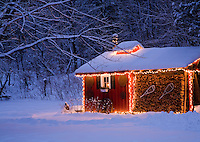 Holiday lights grace a sugarhouse in Putnamville, VT.