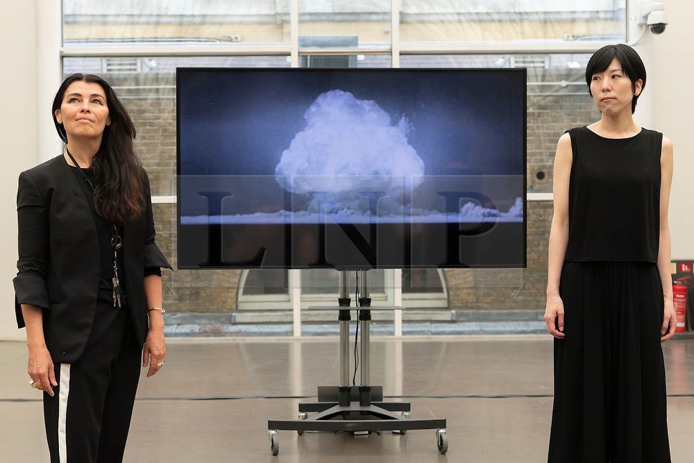 © Licensed to London News Pictures. 06/08/2020. London, UK. Artist Es Devlin and artist Machiko Weston pose next their new Imperial War Museum video commission'I Saw The World End'. The work commemorates the 75th Anniversary of the bombings of Hiroshima an d Nagasaki. Photo credit: Ray Tang/LNP