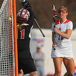 Rutgers junior attacker Annie McGinley scores on Temple senior goalie Tess Bishop. Temple defeated Rutgers 12-11 in NCAA women's college lacrosse at the Rutgers Turf Field in Piscataway, N.J.