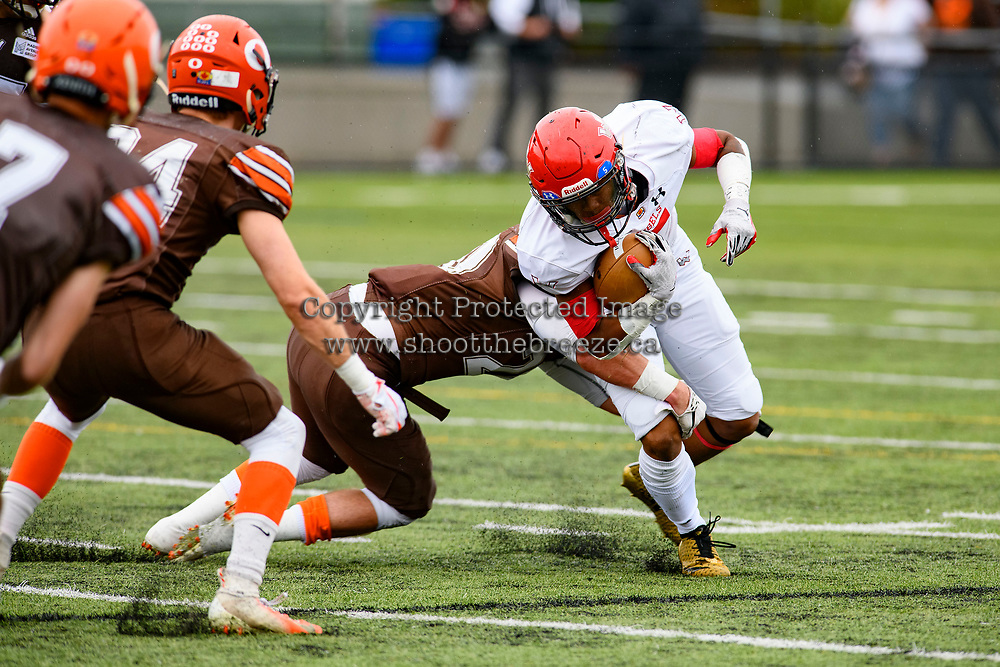 CHILLIWACK, BC - SEPTEMBER 11: Tyler Going #20 of Okanagan Sun tackles Broxx Comia #5 of Westshore Rebels during the first quarter at Exhibition Stadium in Chilliwack, BC, Canada. (Photo by Marissa Baecker/Shoot the Breeze)