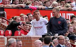 Carrick All Stars manager Harry Redknapp (left) gives instructions to Phil Neville in the dugout during Michael Carrick's Testimonial match at Old Trafford, Manchester.