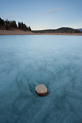 """Rock on Prosser Reservoir"" - Photograph of a rock sitting on top of an icy frozen Prosser Reservoir in Truckee, CA."
