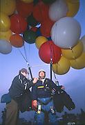 John Ninomiya and associate make a pre-flight check before lift off in Coalinga.