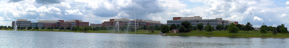 19 July 2009:  State Farm Insurance Companies Corporate South Campus from east of the lake. This image was produced in part utilizing High Dynamic Range (HDR) or panoramic stitching or other computer software manipulation processes. It should not be used editorially without being listed as an illustration or with a disclaimer. It may or may not be an accurate representation of the scene as originally photographed and the finished image is the creation of the photographer.