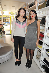 Left to right, MADDIE MILLS and YASMIN MILLS at a party at De Roemer, 14 Porchester Place, London W2 on 1st May 2013.