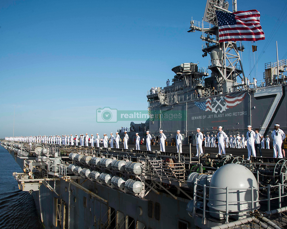 MAYPORT, Fla. (Aug. 9, 2018) Sailors man the rails as the Wasp-class amphibious assault ship USS Iwo Jima (LHD 7) pulls into its homeport of Naval Station Mayport following deployment. The Iwo Jima Amphibious Ready Group completed a regularly-scheduled 6-month deployment to the 5th and 6th Fleet areas of operation. (U.S. Navy photo by Mass Communication Specialist 3rd Class Daniel C. Coxwest/Released)180809-N-AH771-0238