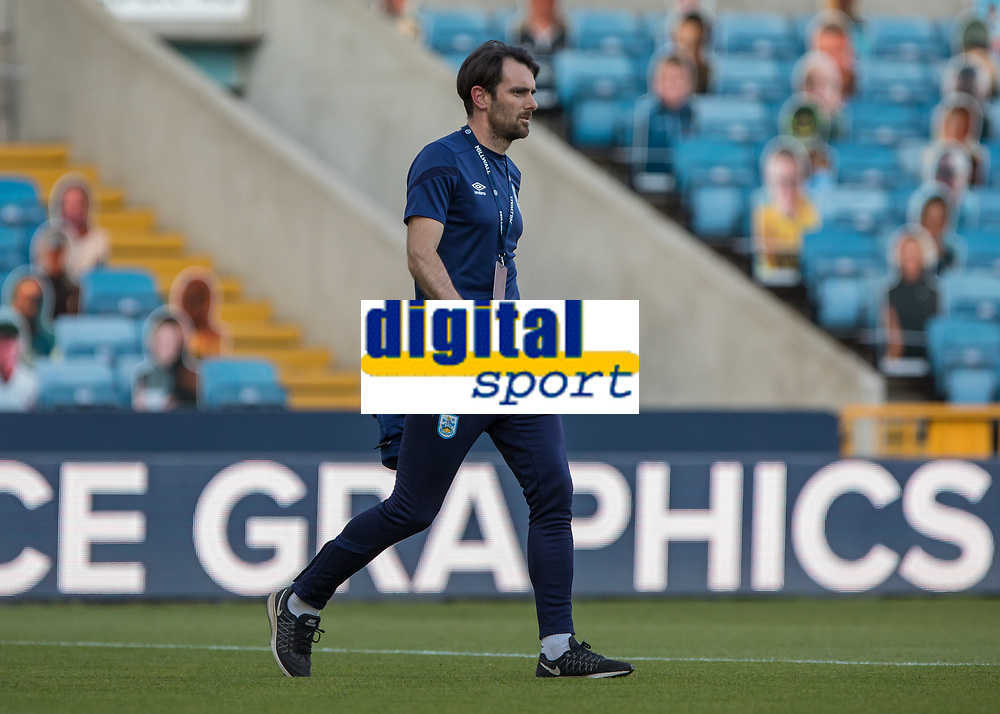 Football - 2019 / 2020 EFL Championship -  Millwall vs. Huddersfield Town<br /> <br /> Danny Schofield, Caretaker manager of Huddersfield Town, makes his way across the pitch for his first game in charge at The Den.<br /> <br /> COLORSPORT/DANIEL BEARHAM