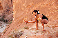 """Native american woman in yoga firefly pose.<br /> :::<br /> """"Krishna articulates the principle succinctly: Acting in unity with your purpose itself creates unification. Actions that consciously support dharma have the power to begin to gather our energy. These outward actions, step by step, shape us inwardly. Find your dharma and do it. And in the process of doing it, energy begins to gather itself into a laser beam of effectiveness.""""<br /> -Stephen Cope, MSW Native American Navajo Woman Yogini. Diné woman practicing yoga in her indigenous red earth environment."""
