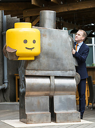 A giant metal warrior with a huge LEGO head – inspired by ancient Chinese sculptures – is among the attractions in a new exhibition hosted by the University of Edinburgh.<br />  <br /> The show – hosted by the Confucius Institute for Scotland, based at the University – features work by 28 artists from each country in the European Union and three artists from China. It runs from 3-30 June in the Church Galleries in Summerhall, Edinburgh.<br />  <br /> The 31 artists took inspiration from the world-renowned terracotta soldiers, which were discovered in 1974 when the tomb of the 3rd Century BC First Chinese Emperor Qin Shi Huang was unearthed in the Xi'an province. The artists considered how these iconic figures could be reinterpreted for the 21st century.<br /> <br /> Pictured:  Slovenian sculptor Bostjan Drinovec has created the Postmodern Man using steel and plastic. The striking work shows an oversized soldier holding his smiling yellow head in his arms.