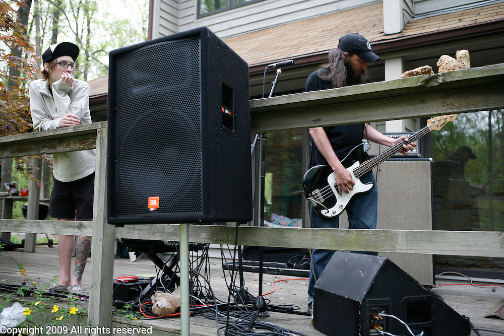 """""""You Will Die,"""" of Indianapolis performs during an outside music show at a house during the Spirit of '68 sponsored Cookout and music performances at """"the Compound"""" in Ellettsville near Bloomington, Indiana. May 2, 2008."""