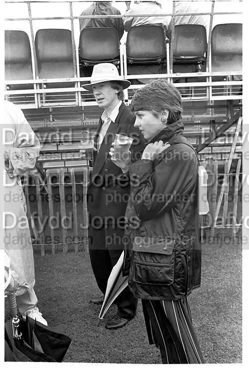 MIKE HOLLINGSWORTH; ANNE DIAMOND, Davidoff Gold Cup, Cowdray Park. 24 July 1987.<br /> <br /> SUPPLIED FOR ONE-TIME USE ONLY> DO NOT ARCHIVE. © Copyright Photograph by Dafydd Jones 248 Clapham Rd.  London SW90PZ Tel 020 7820 0771 www.dafjones.com