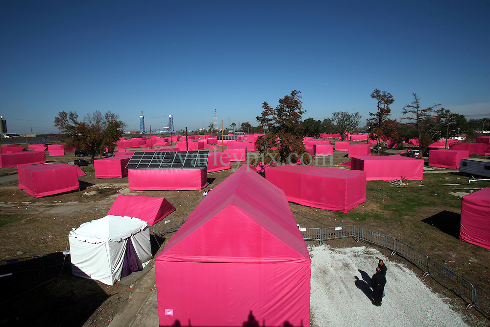 Dec 03 2007. New Orleans, Louisiana. Lower 9th Ward.<br /> Brad Pitt revisits the Lower 9th ward, devastated by Hurricane Katrina to present 'Make it Right' where architects' designs are unveiled to the public. As part of the 'Pink Project' in association with Graft architects of Los Angeles the devastated neighborhood was filled with pink structures to help draw attention to the plight of the area.<br /> Photo credit; Charlie Varley.
