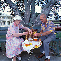 New Zealand, (MR) Alec Goldsmith & Sadie Gilliam meet for afternoon tea along the Devonport waterfront near Auckland