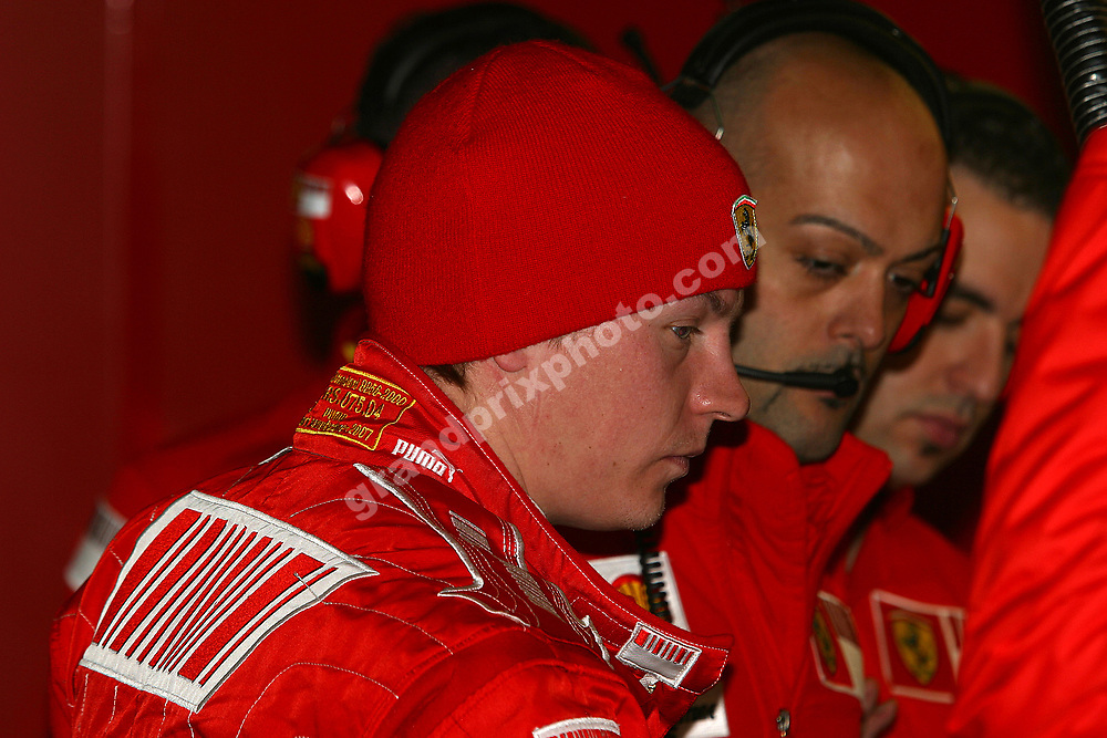 Kimi Raikkonen and Ferrari engineers in the pits during testing at the Circuit de Catalunya outside Barcelona in late February 2008. Photo: Grand Prix Photo