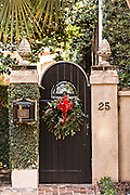 Christmas wreath on the door of a historic home in Charleston, South Carolina.