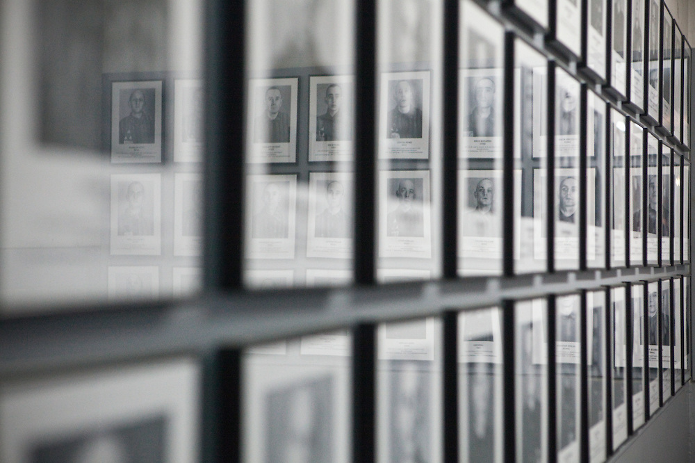 Framed photographs of male camp inmates, Auschwitz, Poland.