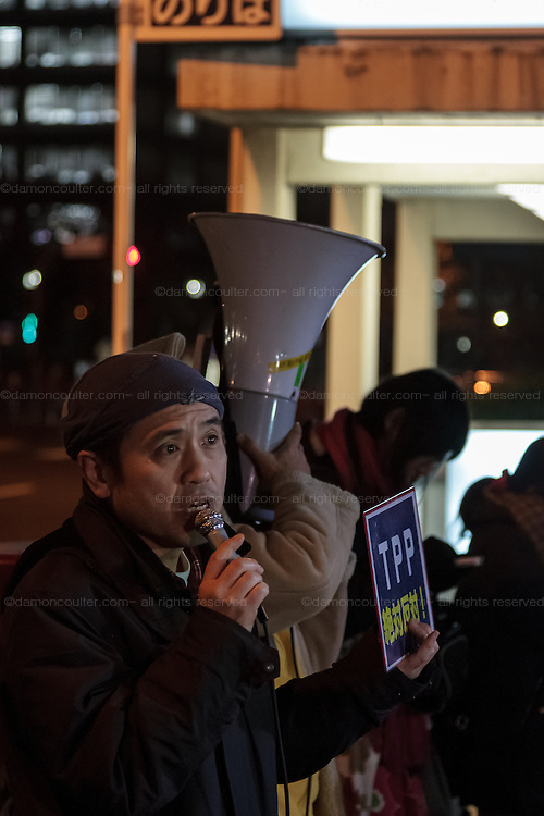 Activists take part in a small protest against the TPP trade agreement (Trans- Pacific partnership) outside the Ministry Of the Economy, Trade and Industry (METI) in Kasumigaseki, Tokyo, Japan. Friday February 5th 2016.  The Trans Pacific Partnership, one of the biggest multinational trade deals ever made was signed by ministers from 12 nations, including Japan, in New Zealand on Thursday February 4th. Many people in Japan are against the agreement..