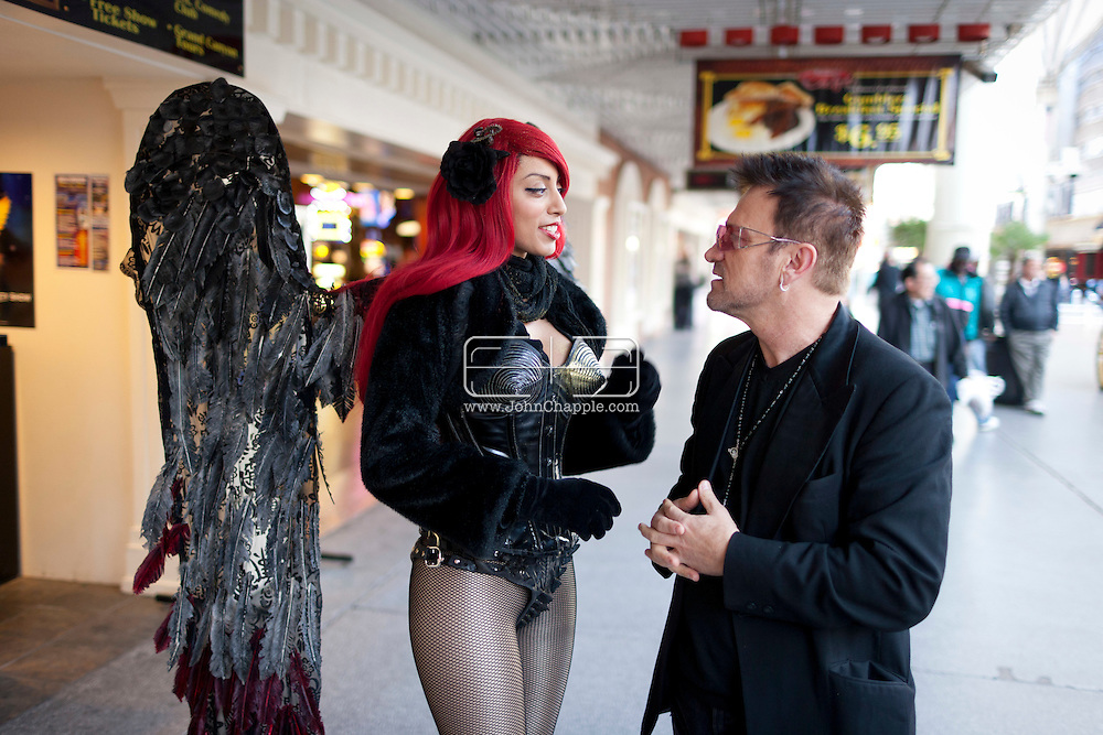 February 20th, 2012, Las Vegas, Nevada. The 21st Annual Reel Awards in Las Vegas where celebrity lookalikes show off their talents. Pictured is Pavel Sfera as Bono with Las Vegas street performer,  Dark Angel..PHOTO © JOHN CHAPPLE / www.johnchapple.com.