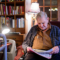 020515       Cable Hoover<br /> <br /> Lifetime Ramah resident Deward Bond flips through old photographs at his home in Ramah Thursday. Bond worked in the Master Brothers' Store for 25 years while his family owned it.