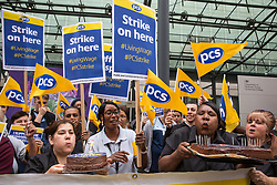 London, UK. 15 July, 2019. Catering, security, postal, porter and cleaning staff belonging to the PCS trade union and outsourced to work at the Department for Business, Energy and Industrial Strategy (BEIS) via contractors ISS World and Aramark stand on the picket line outside the Government department after walking out on an indefinite strike for the London Living Wage, terms and conditions comparable to the civil servants they work alongside and an end to outsourcing.