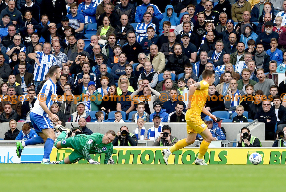 Jordan Hugill of Preston  goes round Brighton's David Stockdale to score for Preston during the Sky Bet Championship match between Brighton and Hove Albion and Preston North End at the American Express Community Stadium in Brighton and Hove. October 15, 2016.<br /> Liz  Finlayson / Telephoto Images<br /> +44 7967 642437