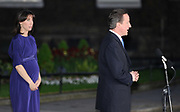 "Britain's new prime minister David Cameron (R) arrives in Downing Street with his wife Samantha, May 12, 2010 and pledged to build a strong stable and responsible coalition government with the Liberal Democrats and to lead the country to ""better times ahead""."