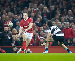 Josh Adams of Wales gets the ball away<br /> <br /> Photographer Simon King/Replay Images<br /> <br /> Friendly - Wales v Barbarians - Saturday 30th November 2019 - Principality Stadium - Cardiff<br /> <br /> World Copyright © Replay Images . All rights reserved. info@replayimages.co.uk - http://replayimages.co.uk