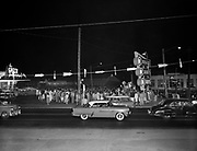 """8609-D15.  Speck Drive In, July 27, 1956, 41 available negatives both 4x5"""" and 120mm, all B&W.  Hamburger eating contest with live KEX radio broadcast, the air personalities are emceeing the event.  5005 SE Foster Road, at Powell, on east side of street and south of intersection, a well-known Portland drive in location, and one of the few still functioning today. Portland, Oregon."""