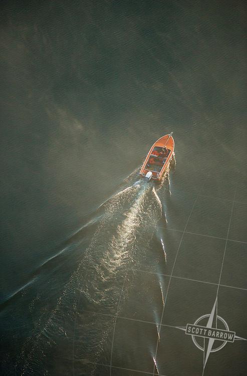 Boat on Richmond Pond in fog. Richmond, MA.