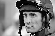 """Jump jockey Dougie Costello waits for the """"riders up"""" command at Cheltenham race course on November 13, 2010."""
