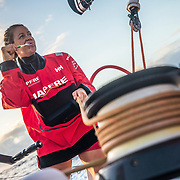 Leg 4, Melbourne to Hong Kong, day 15 on board MAPFRE, life on board, when you dont have enough time for yourself, Sophie Ciszek in a busy morning. Photo by Ugo Fonolla/Volvo Ocean Race. 15 January, 2018.