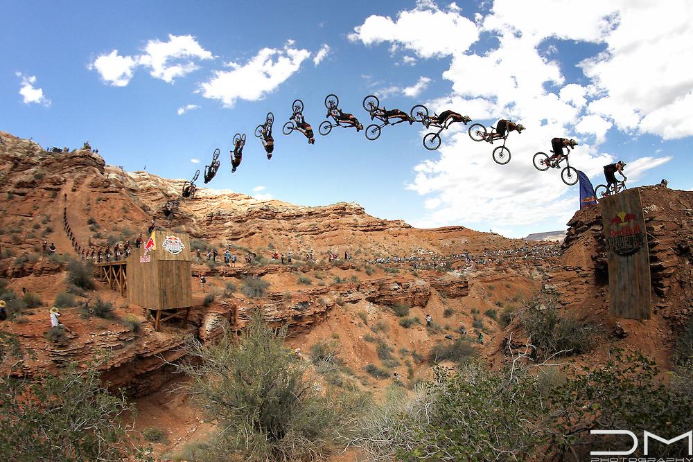 Szymon Godziek doing a backflip at the Canyon Gap in the Red Bull Rampage in Virgin (Utah).