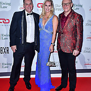 John Caudwell (R) arrive at Float Like A Butterfly Ball for Caudwell Children Charity at Grosvenor House Hotel on 16 November 2019, London, UK.
