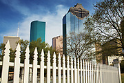 Image of downtown buildings and a white fence in Houston, Texas, American South by Randy Wells