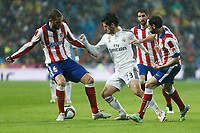 Real Madrid´s Isco (C) and Atletico de Madrid´s Mario Suarez and Juanfran during Spanish King´s Cup match at Santiago Bernabeu stadium in Madrid, Spain. January 15, 2015. (ALTERPHOTOS/Victor Blanco)