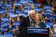 Jane Sanders kisses husband Bernie Sanders after a campaign rally at Penn State on April 19, 2016.