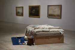 "@Licensed to London News Pictures 12/10/2017. Margate, Kent. British artist Tracey Emin most contemporary work of art ""My Bed 1998""  is on display at the Turner Contemporary art gallery in her home town Margate in Kent. Commonly know as her Unmade Bed features stained sheets, cigarette packets, discarded condoms and dirty underwear and is on display until the 14th of January at the Turner Contemporary art gallery in Margate, Kent.. Photo credit: Manu Palomeque/LNP"