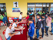 09 JULY 2014 - ARANYAPRATHET, SA KAEO, THAILAND: Cambodian migrant workers check in before entering the Thai Immigration One Stop Service Center in Aranyaprathet on the Thai-Cambodian border. More than 200,000 Cambodian migrant workers, most undocumented, fled Thailand in early June fearing a crackdown by Thai authorities after a coup unseated the elected government. Employers have been unable to fill the vacancies created by the Cambodian exodus and the Thai government has allowed them to return. The Cambodian workers have to have a job and their employers have to vouch for them. The Thai government is issuing temporary ID cards to allow them to travel openly to their jobs. About 800 Cambodian workers came back to Thailand through the Aranyaprathet border crossing Wednesday. The Thai government has opening similar service centers at three other crossing points on the Thai-Cambodian border.    PHOTO BY JACK KURTZ