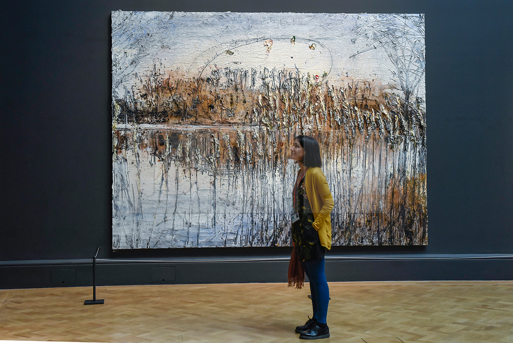 """© Licensed to London News Pictures. 08/06/2017. London, UK. A visitor stands in front of """"Und Du Bist Maler Geworden"""" by Anselm Kiefer Hon RA.  Preview of the Summer Exhibition 2017 at the Royal Academy of Arts in Piccadilly.  Co-ordinated by Royal Academician Eileen Cooper, the 249th Summer Exhibition is the world's largest open submission exhibition with around 1,100 works on display by high profile and up and coming artists.<br />  Photo credit : Stephen Chung/LNP"""