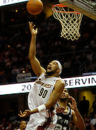 PHOTO BY DAVID RICHARD.Drew Gooden puts up a reverse layup against Tim Duncan of San Antonio last night in the second quarter.