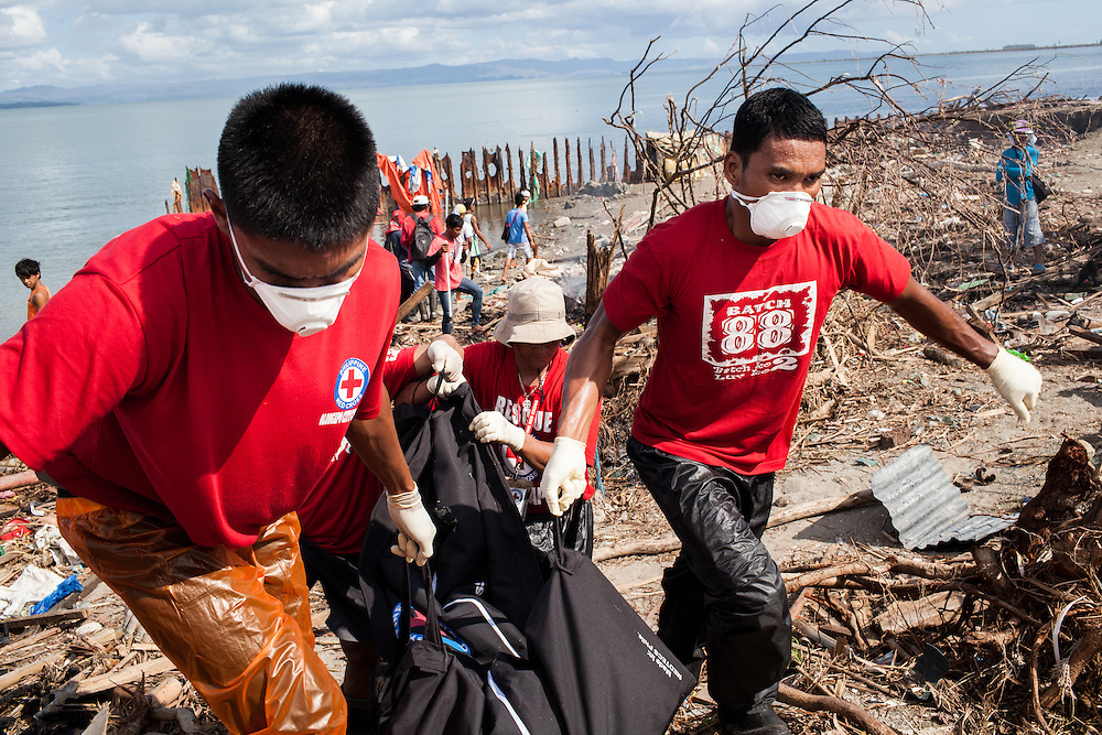 Red Cross Volunteers removed a body that was discovered buried under debris.