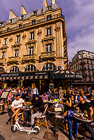 People at sidewalk cafe Le Saint Severin on Place St. Michel, Sorbonne/Latin Quarter area, Paris, France.