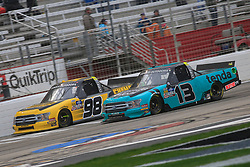 February 23, 2019 - Hampton, GA, U.S. - HAMPTON, GA - FEBRUARY 23:   #13: Johnny Sauter, ThorSport Racing, Ford F-150 and #98: Grant Enfinger, ThorSport Racing, Ford F-150 Champion Power Equipment battle for position during the 11th running of the Ultimate Tailgating 200 NASCAR Gander Outdoors Truck Series race on February 23, 2019 at the Atlanta Motor Speedway in Hampton, GA.  (Photo by David J. Griffin/Icon Sportswire) (Credit Image: © David J. Griffin/Icon SMI via ZUMA Press)