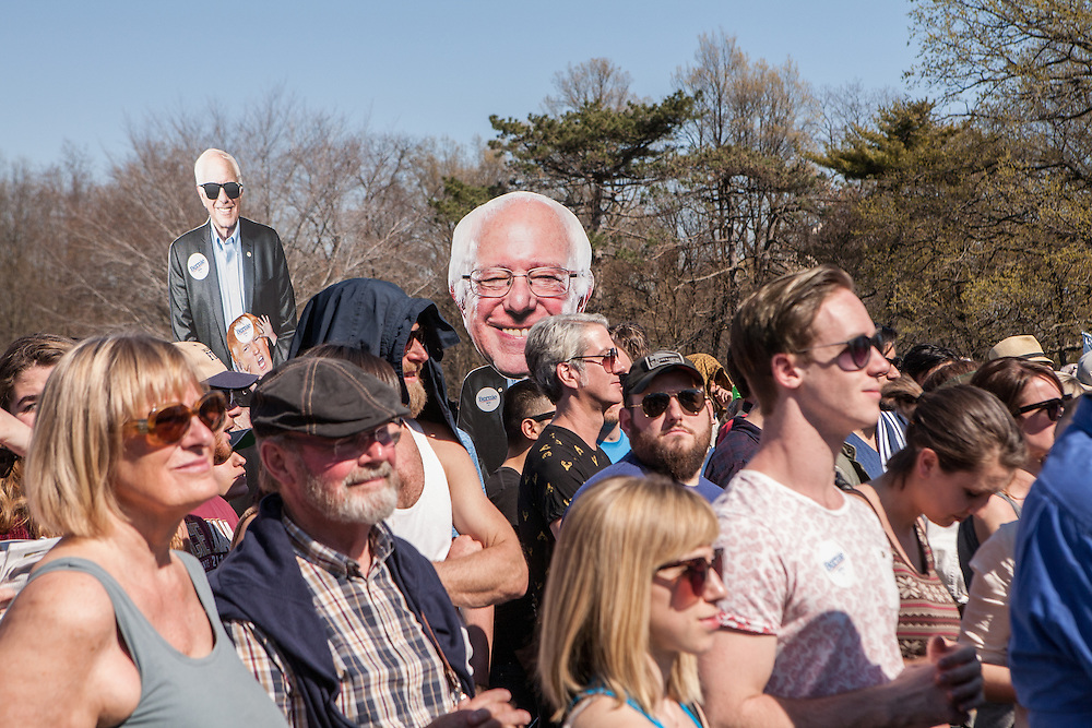 """Brooklyn, NY - 17 April 2016. Larger than life-sized images of Sander over the crowd.  Vermont Senator Bernie Sanders, who is running as a Democrat in the U.S. Presidential primary elections, held a campaign """"get out the  vote"""" rally in Brooklyn's Prospect Park."""