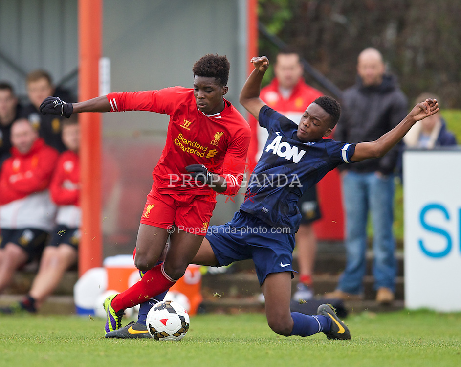 LIVERPOOL, ENGLAND - Saturday, December 7, 2013: Liverpool's Sheyi Ojo in action against Manchester United's Matthew Willock during the Premier League Academy match at the Kirkby Academy. (Pic by David Rawcliffe/Propaganda)