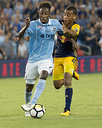 September 20, 2017 - Kansas City, Kansas, U.S - Sporting KC forward Gerso Fernandes #7 (l) maneuvers the ball against the defense of NY Red Bulls midfielder Tyler Adams #4 (r) during the first half of the game. Sporting KC will win the 2017 Lamar Hunt Open Cup championship with a score of 2-1 over the New York Red Bulls. (Credit Image: © Serena S.Y. Hsu via ZUMA Wire)